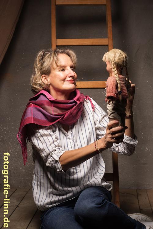 Puppe mit Zöpfen